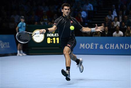 Djokovic of Serbia plays a shot to Nadal of Spain during their their men's final singles tennis match at the ATP World Tour Finals in London