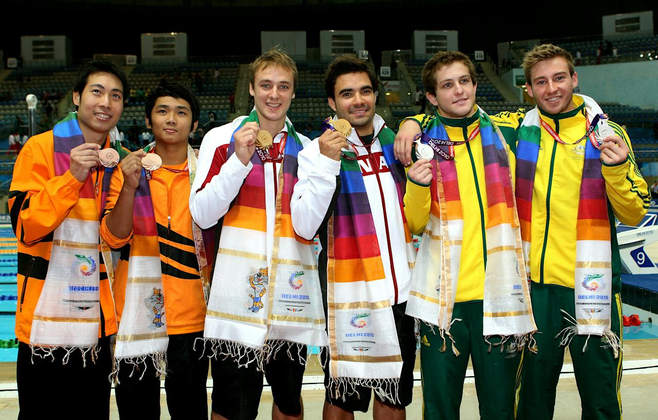DELHI, INDIA - OCTOBER 12:  (L to R)  Ken Nee Yeoh and Bryan Lomas (bronze) of Malaysia, Reuben Ross and Alexandre Despatie (gold) of Canada and Ethan Warren and Matthew Mitcham (silver) of Australia pose with the medals won in the Men's 3m Synchro Springboard Final at Dr. S.P. Mukherjee Aquatics Complex on day nine of the Delhi 2010 Commonwealth Games on October 12, 2010 in Delhi, India.  (Photo by Cameron Spencer/Getty Images)