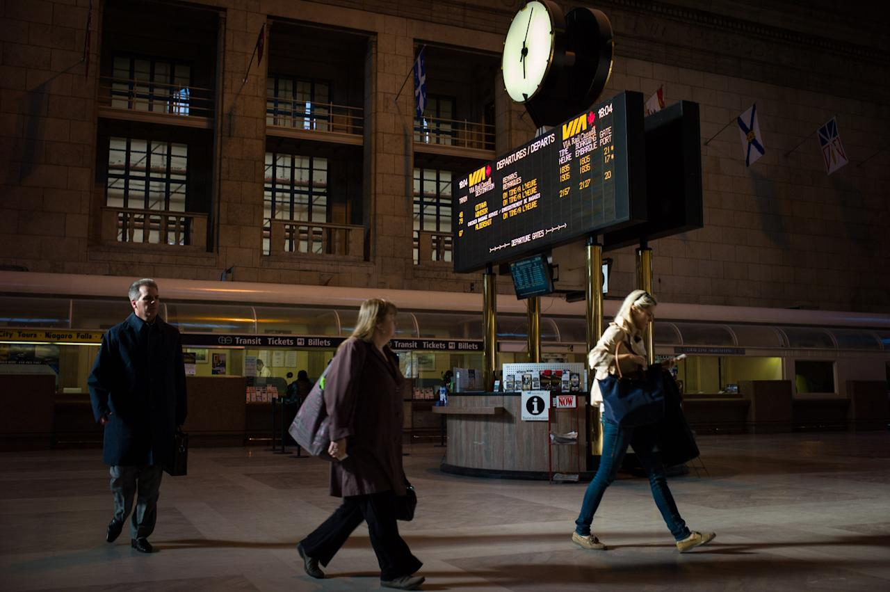TORONTO, CANADA -  APRIL 22:  Commuters walk to their trains at Union Station, the heart of VIA Rail travel, on April 22, 2013 in Toronto, Ontario, Canada. The Royal Canadian Mounted Police (RCMP) report they have arrested two people connected to an alleged Al Qaeda plot to detonate a bomb on a VIA Rail train in Canada.  (Photo by Ian Willms/Getty Images)