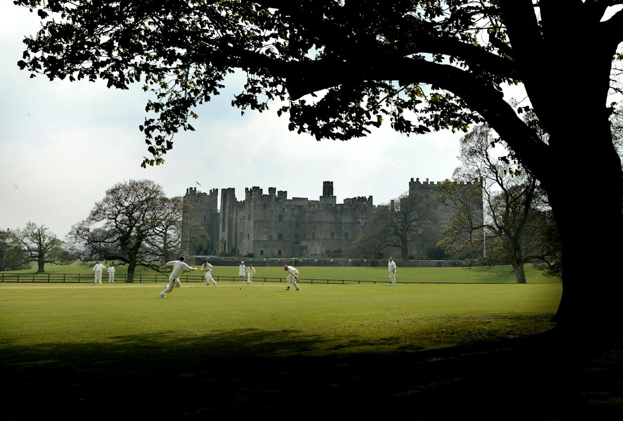 STAINDROP, ENGLAND - MAY 06: Cricketers from Raby Castle Cricket Club play at the foot of Raby Castle on May 6, 2006 in the Village of Staindrop, England.  (Photo by Laurence Griffiths/Getty Images)