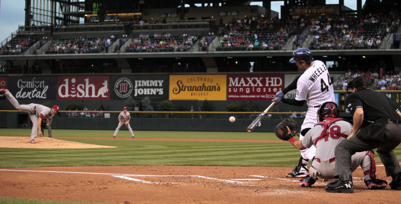 Rockies end 7-game slide with 10-5 win over Cards