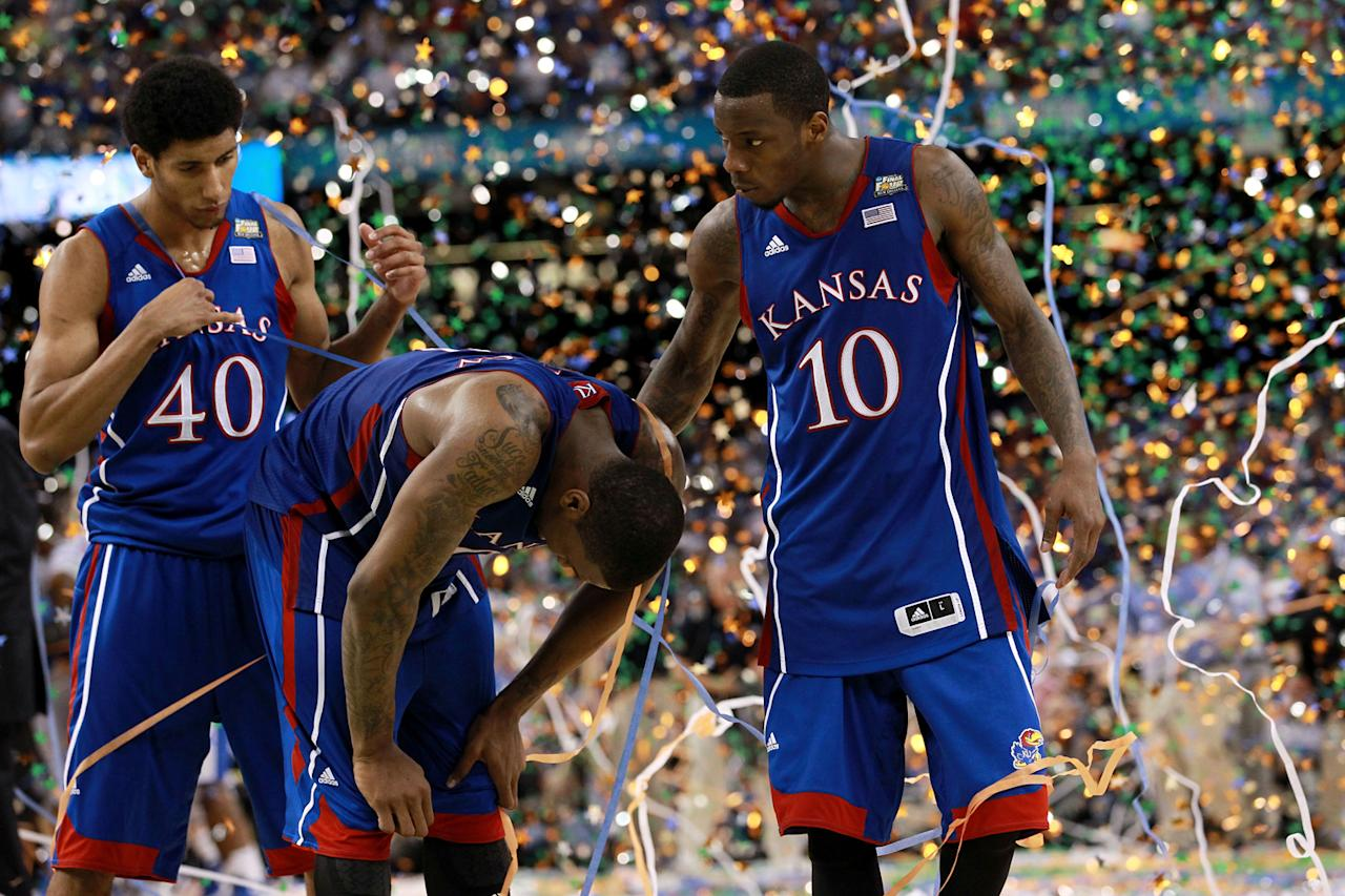 Kevin Young #40, Thomas Robinson #0 and Tyshawn Taylor #10 of the Kansas Jayhawks react after losing to the Kentucky Wildcats 67-59 in the National Championship Game of the 2012 NCAA Division I Men's Basketball Tournament at the Mercedes-Benz Superdome on April 2, 2012 in New Orleans, Louisiana. (Photo by Ronald Martinez/Getty Images)