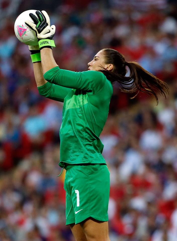 LONDON, ENGLAND - AUGUST 09:  Goalkeeper Hope Solo #1 of United States makes a save in the first half while taking on Japan during the Women's Football gold medal match on Day 13 of the London 2012 Olympic Games at Wembley Stadium on August 9, 2012 in London, England.  (Photo by Jamie Squire/Getty Images)