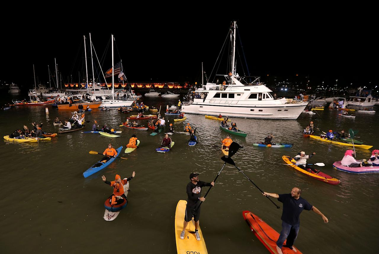 SAN FRANCISCO, CA - OCTOBER 24:  San Francisco Giants fans cheer on boats and kayaks in McCovey Cove during Game One between the San Francisco Giants and the Detroit Tigers in the Major League Baseball World Series at AT&T Park on October 24, 2012 in San Francisco, California.  (Photo by Ezra Shaw/Getty Images)