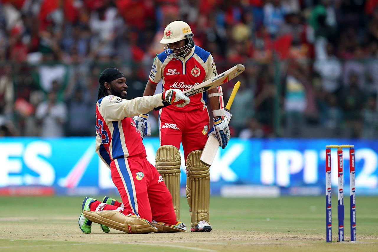 Chris Gayle acknowledges on hitting century during match 31 of the Pepsi Indian Premier League between The Royal Challengers Bangalore and The Pune Warriors India held at the M. Chinnaswamy Stadium, Bengaluru  on the 23rd April 2013Photo by Prashant Bhoot-IPL-SPORTZPICS  Use of this image is subject to the terms and conditions as outlined by the BCCI. These terms can be found by following this link:http://www.sportzpics.co.za/image/I0000SoRagM2cIEc