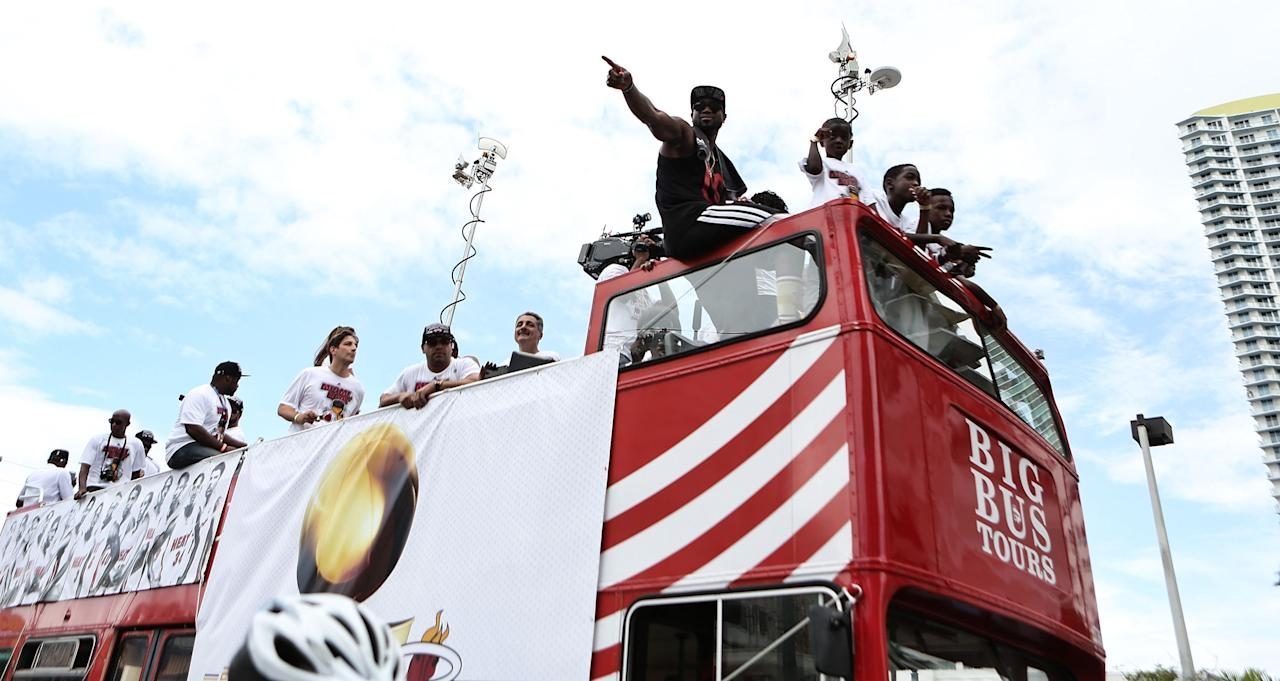 MIAMI, FL - JUNE 24: Guard Dwyane Wade #3 of the Miami Heat rides a bus during the NBA championship victory parade on the streets on June 24, 2013 in Miami, Florida. The Miami Heat defeated the San Antonio Spurs in the NBA Finals. (Photo by Marc Serota/Getty Images)