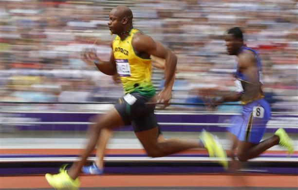 Asafa Powell of Jamaica runs on his way to winning his 100m heat round 1 during the London 2012 Olympic Games at the Olympic Stadium August 4, 2012.