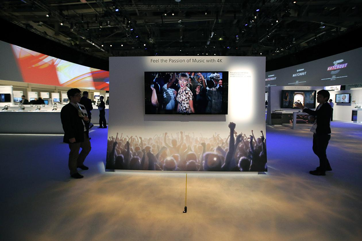 Technicians install Sony's 4k Ultra HD television at the Sony booth at the International Consumer Electronics Show.