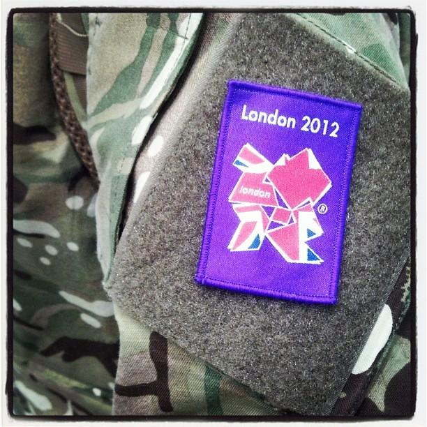 There's a strong military presence near the Olympic Village; each uniform has this patch (via @wyshynski)