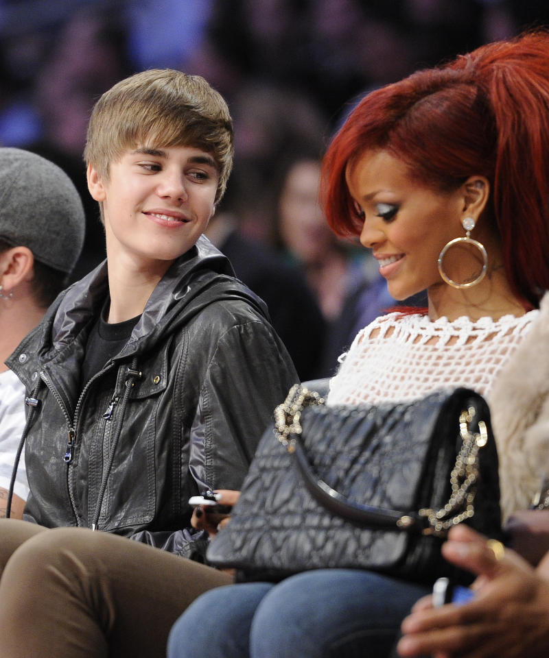 Justin Bieber talks to Rihanna during the second half of the NBA basketball All-Star Game on Sunday, Feb. 20, 2011, in Los Angeles.