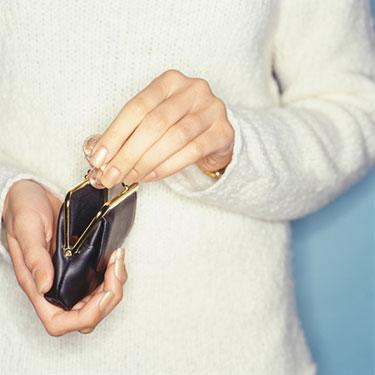 Woman-taking-coins-from-purse-close-up-of-hands_web