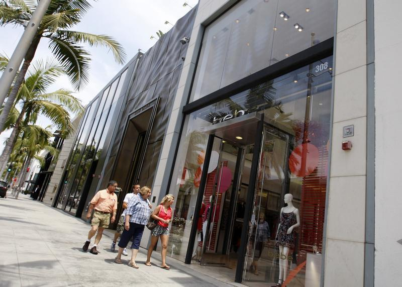 People walk past the Bebe store on Rodeo Drive in Beverly Hills