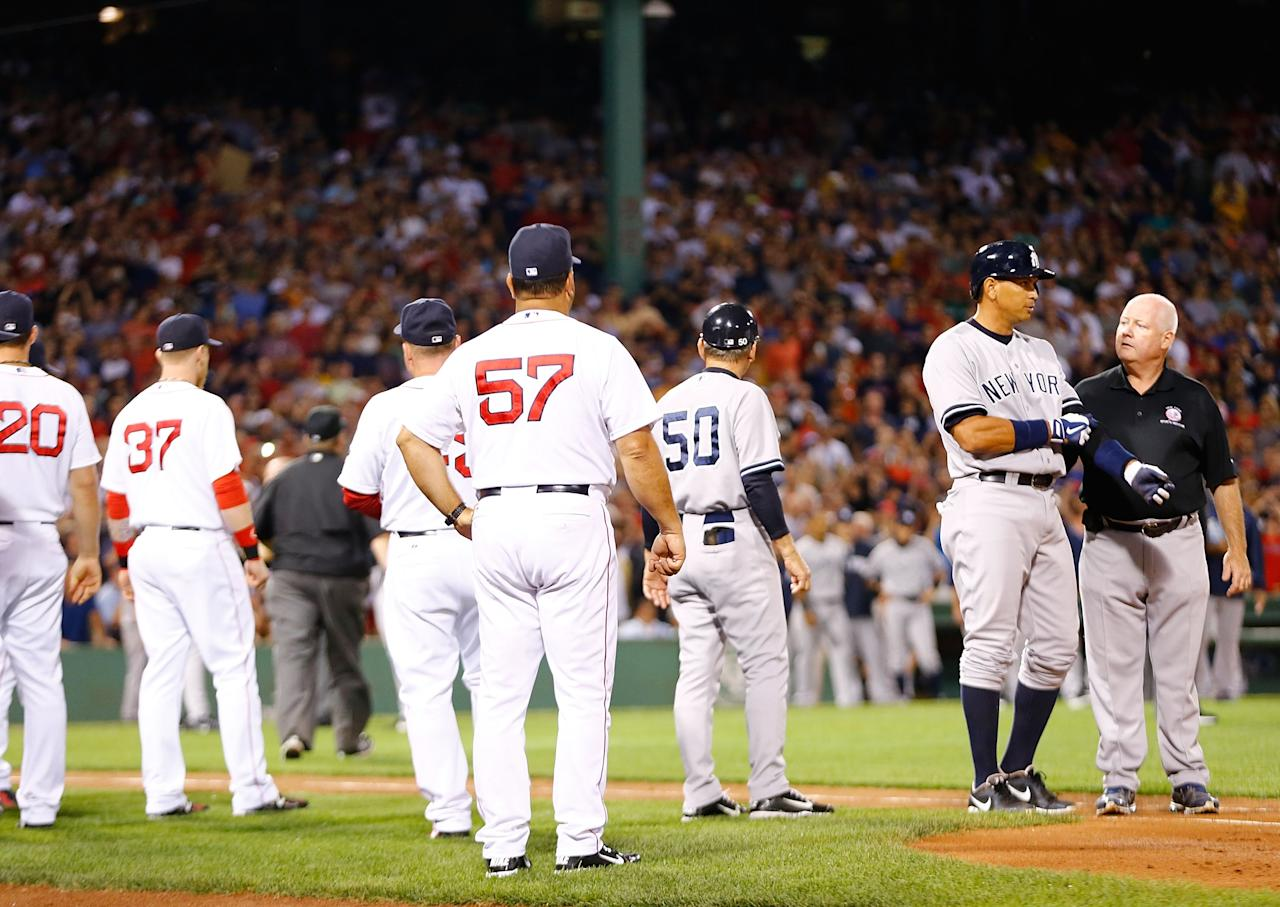 BOSTON, MA - AUGUST 18: Alex Rodriguez #13 of the New York Yankees walks to first base with a trainer after being hit by a pitch in the 2nd inning by Ryan Dempster #46 of the Boston Red Sox during the game on August 18, 2013 at Fenway Park in Boston, Massachusetts. Both benches were warned and manager Joe Girardi #28 of the New York Yankees was ejected. (Photo by Jared Wickerham/Getty Images)