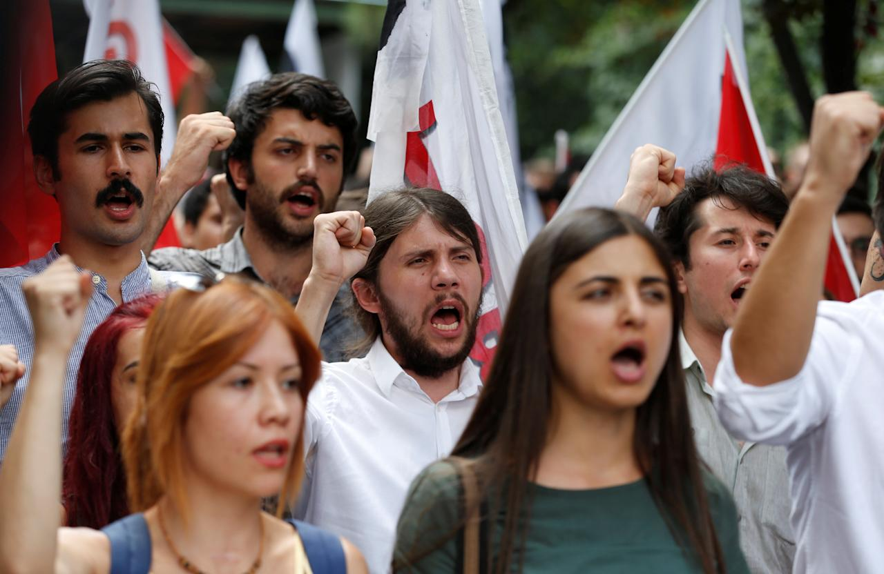 Members of the ultra-nationalist Turkish Youth Association (TGB) take part in a protest against academics close to U.S.-based cleric Fethullah Gulen in front of Ankara University in Ankara, Turkey, July 21, 2016.REUTERS/Baz Ratner