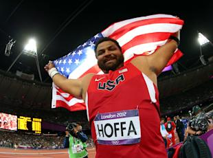 Reese Hoffa of the United States celebrates his bronze medal in the Men's Shot Put Final on Day 7. (Photo by Alexander Hassenstein/Getty Images)