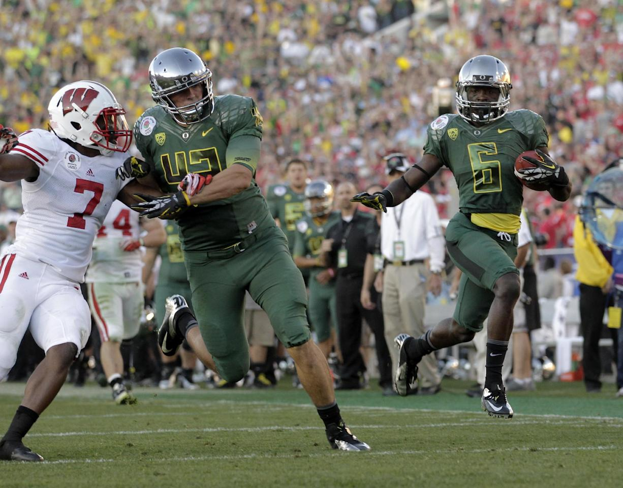 Oregon's De'Anthony Thomas (6) runs for a touchdown during the second half of the Rose Bowl NCAA college football game against Wisconsin on Monday, Jan. 2, 2012, in Pasadena, Calif. (AP Photo/Jae C. Hong)