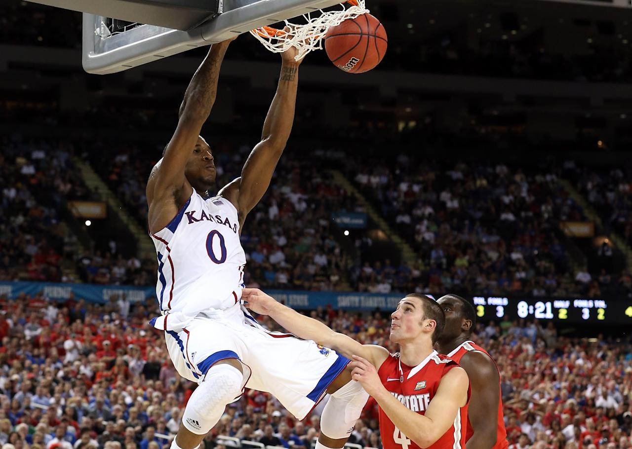 NEW ORLEANS, LA - MARCH 31:  Thomas Robinson #0 of the Kansas Jayhawks dunks the ball against Aaron Craft #4 of the Ohio State Buckeyes in the second half during the National Semifinal game of the 2012 NCAA Division I Men's Basketball Championship at the Mercedes-Benz Superdome on March 31, 2012 in New Orleans, Louisiana.  (Photo by Jeff Gross/Getty Images)