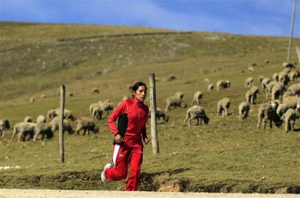 Marathon runner Gladys Tejeda, the first Peruvian athlete who qualified for the 2012 London Olympic Games, runs during her training in the Andean province of Junin, May 14, 2012.