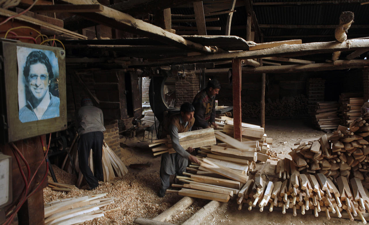 HAlMULLAH, KASHMIR, INDIA - FEBRUARY 16: Workers in a cricket bat factory on February 16, 2011 in Halmullah, near Srinagar, in Kashmir, India.  Cricket bat manufacturers in India are experiencing a boom with the Cricket World Cup beginning in South Asia on February 19. Kashmir willow, whilst less valuable than English willow is widely used in cricket bats found across the globe, and manufacturers in Kashmir are hoping to increase exports on the back of the World Cup interest. Cricket bats in Kashmir made from local willow can be bought for as little as US$11, whereas its English counterpart can command prices of at least US$170. (Photo by Yawar Nazir/Getty Images)