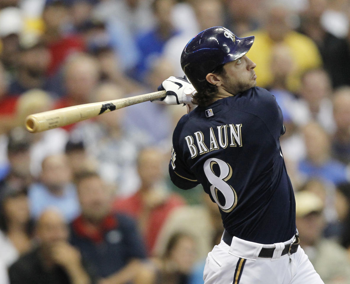 Milwaukee Brewers' Ryan Braun follows through for a home run during the fourth inning of a baseball game against the Los Angeles Dodgers Monday, Aug. 15, 2011, in Milwaukee. (AP Photo/Jeffrey Phelps)
