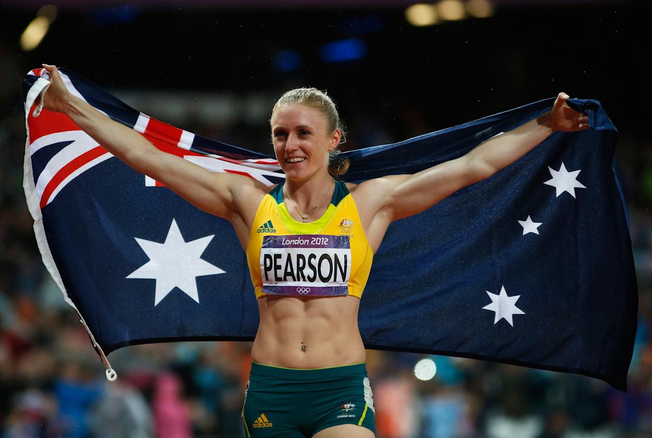 LONDON, ENGLAND - AUGUST 07:  Sally Pearson of Australia celebrates after winning the gold medal in the Women's 100m Hurdles Final on Day 11 of the London 2012 Olympic Games at Olympic Stadium on August 7, 2012 in London, England.  (Photo by Jamie Squire/Getty Images)
