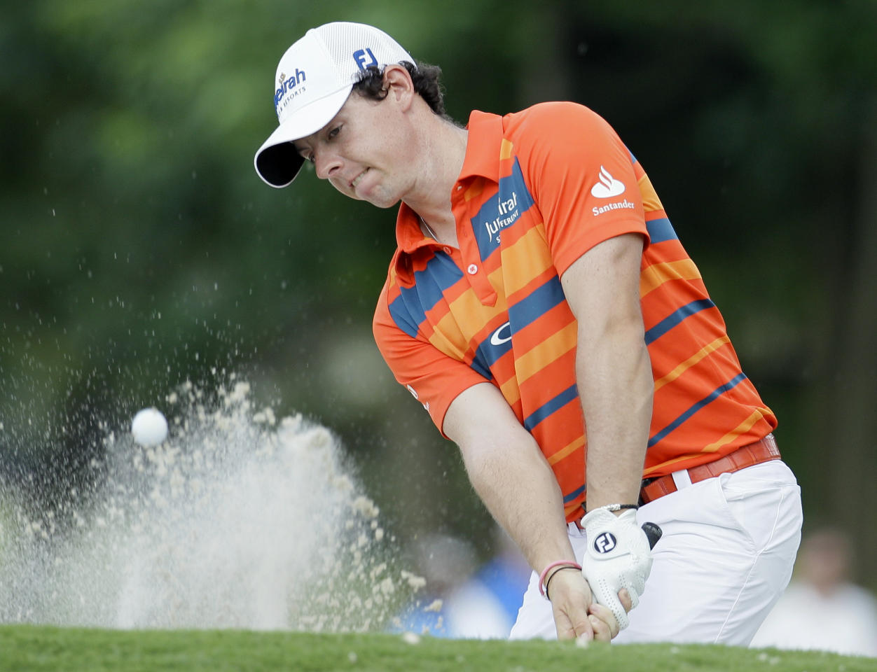 Rory McIlroy, of Northern Ireland, hits from the sand on the 17th hole during the second round of the St. Jude Classic golf tournament on Friday, June 8, 2012, in Memphis, Tenn. McIlroy finished with a two-round score of 7-under-par 133. (AP Photo/Mark Humphrey)