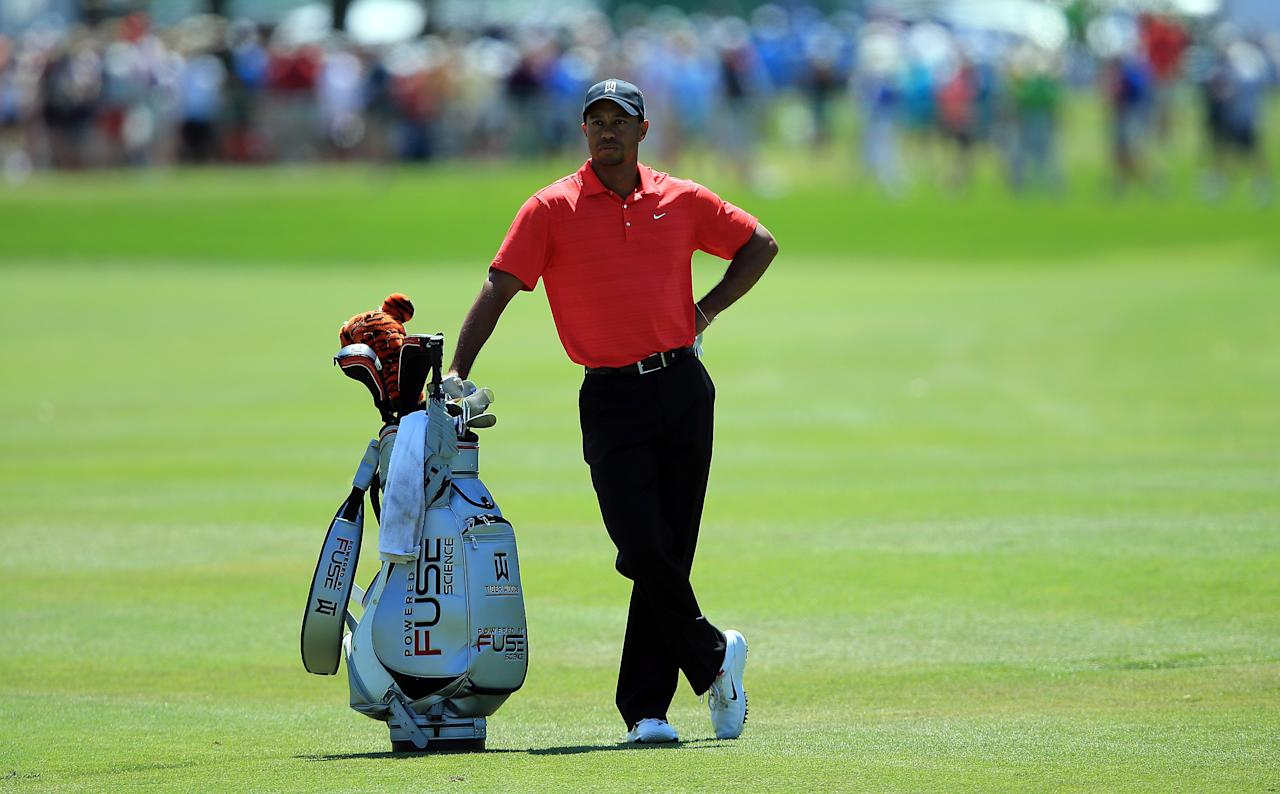 Tiger Woods of the USA waits to play his second shot at the par 4, first hole during the final round of the 2012 Arnold Palmer Invitational presented by MasterCard at Bay Hill Club and Lodge in Orlando, Florida. Woods won the Arnold Palmer Invitational at the Bay Hill golf course Sunday with a five shot victory over Graeme McDowell. (AFP Photo/David Cannon)