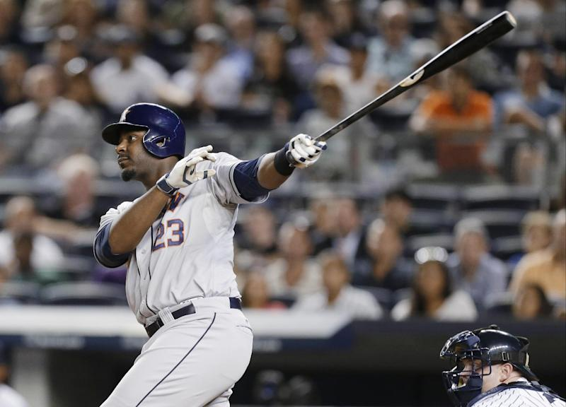 Carter hits 3-run HR in 9th, Astros top Yanks 7-4