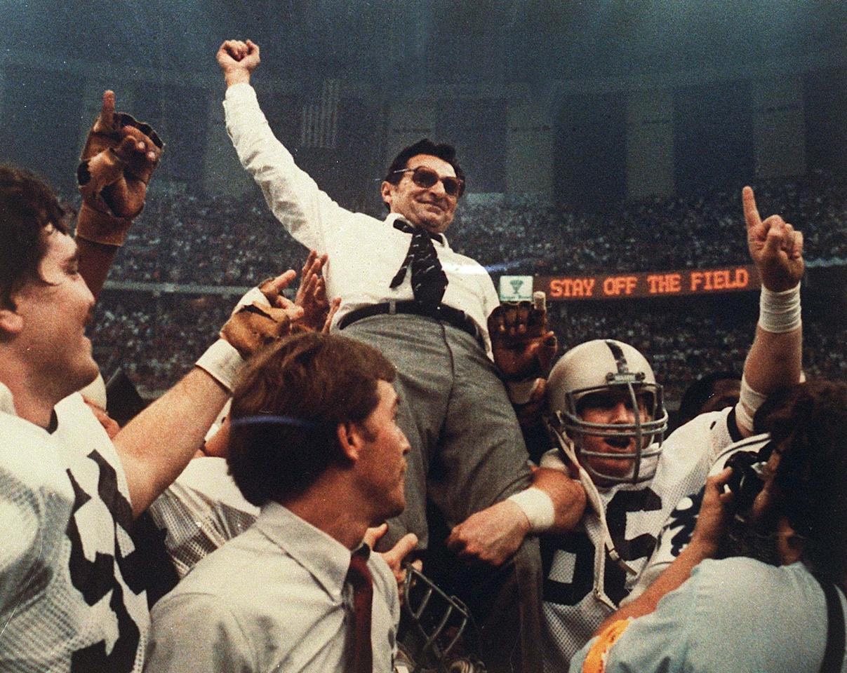 THIS CORRECTS THE DATE TO JAN. 1, 1983, NOT JAN. 2 - FILE - In this Jan. 1, 1983 file photo, Penn State football coach Joe Paterno celebrates as he is carried off the field after a 27-23 victory against Georgia in the Sugar Bowl, to claim the national championship, at the Superdome in New Orleans. Paterno say he plans to retire at the end of the season, his long and illustrious career brought down because he failed to do all he could about an allegation of child sex abuse against a former assistant. (AP Photo/File)