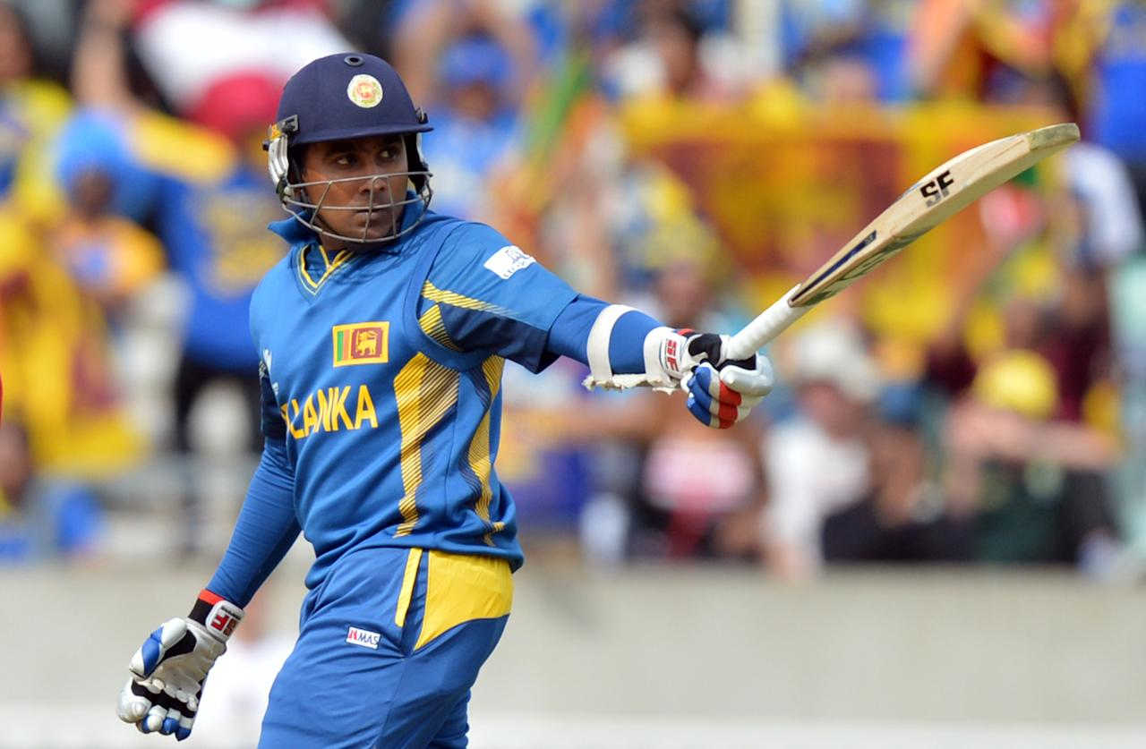 Sri Lanka's Mahela Jayawardene celebrates scoring 50 not out during the ICC Champions Trophy match at The Oval, London.