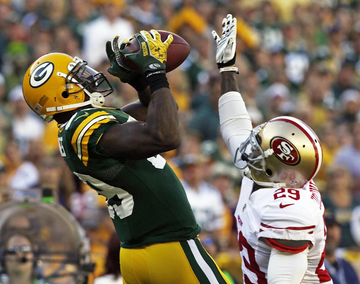 Green Bay Packers' James Jones (89) catches a pass in front of San Francisco 49ers' Chris Culliver (29) during the first half of an NFL football game Sunday, Sept. 9, 2012, in Green Bay, Wis. (AP Photo/Jeffrey Phelps)