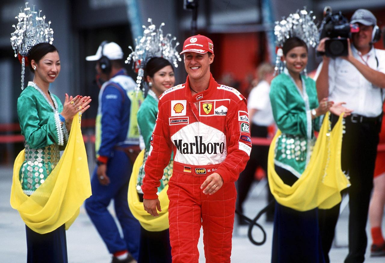 SEPANG, MALAYSIA - OCTOBER 22:  GP von MALAYSIA 2000 in Sepang; Michael SCHUMACHER/GER - FERRARI - beim PITWALK  (Photo by Andreas Rentz/Bongarts/Getty Images)
