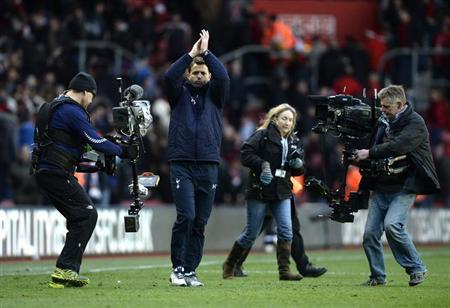 Tottenham Hotspur caretaker manager Tim Sherwood gestures to fans after winning their English Premier League soccer match against Southampton at St Mary's stadium in Southampton