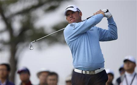 Lee Westwood of U.S. tees off on the second hole during the BMW Masters 2013 golf tournament at Lake Malaren Golf Club in Shanghai