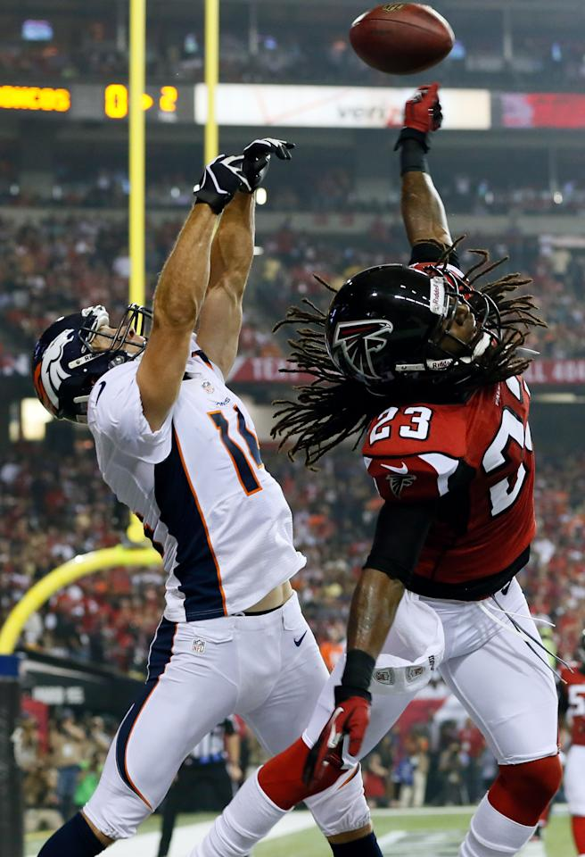 ATLANTA, GA - SEPTEMBER 17:  Cornerback Dunta Robinson #23 of the Atlanta Falcons breaks up a pass intended for wide receiver Brandon Stokley #14 of the Denver Broncos in the end zone during a game at the Georgia Dome on September 17, 2012 in Atlanta, Georgia.  (Photo by Kevin C. Cox/Getty Images)
