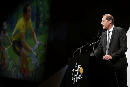 Tour de France director Christian Prudhomme speaks as five time tour de France winner Bernard Hinault is seen on a giant screen during the presentation of the itinerary of the 2017 Tour de France cycling race in Paris, France, October 18, 2016. REUTERS/Benoit Tessier