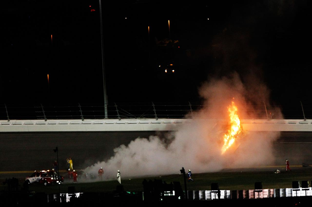 DAYTONA BEACH, FL - FEBRUARY 27:  A jet dryer bursts into flames after being hit by Juan Pablo Montoya, driver of the #42 Target Chevrolet, under caution during the NASCAR Sprint Cup Series Daytona 500 at Daytona International Speedway on February 27, 2012 in Daytona Beach, Florida.  (Photo by Tom Pennington/Getty Images for NASCAR)