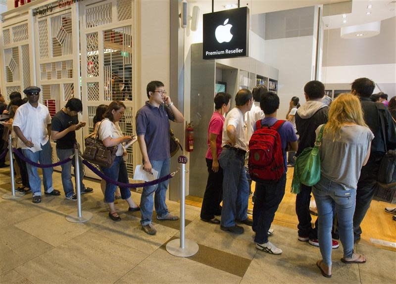 File photo of people lining up outside an Apple retail shop during the launch of the Apple iPad in Singapore