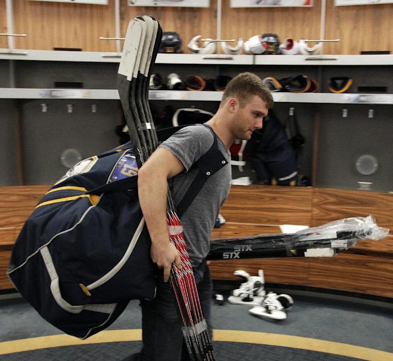 Buffalo Sabres center Cody Hodgson exits the Buffalo Sabres' locker room with his equipment after players gathered for the last time on Monday, April 14, 2014, after the NHL hockey team clinched the NHL's worst record, in Buffalo, N.Y