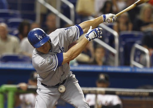 Los Angeles Dodgers batter Mark Ellis hits a foul ball during the second inning of a baseball game in Miami, Saturday, Aug. 11, 2012 against the Miami Marlins. (AP Photo/J Pat Carter)