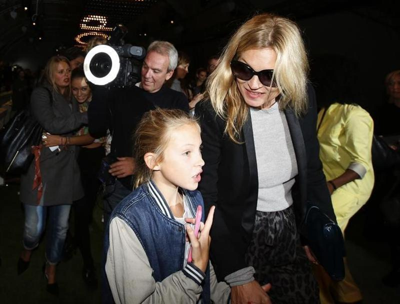 British model Kate Moss leaves the Topshop Unique Spring/Summer 2014 collection with her daughter Lila Grace during London Fashion Week