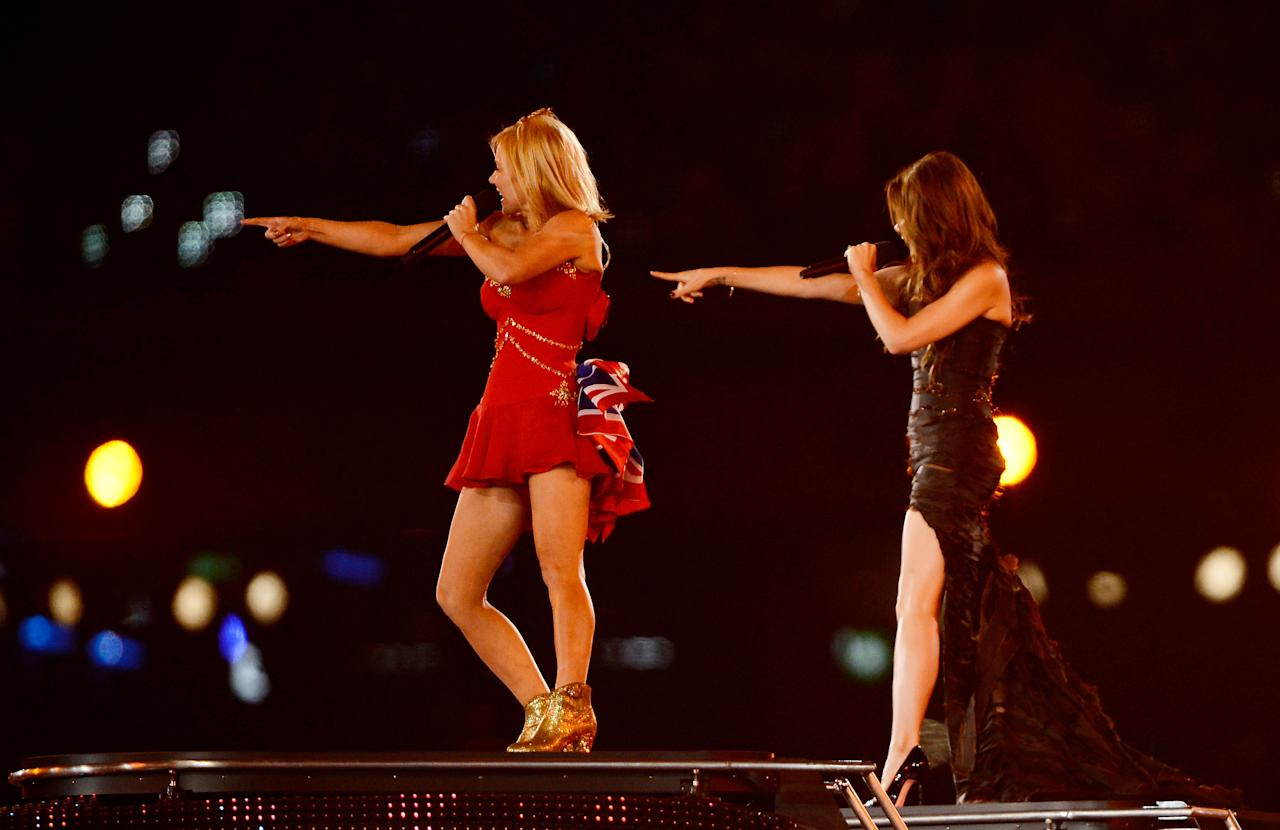 LONDON, ENGLAND - AUGUST 12: Emma Bunton and  Victoria Beckham of the Spice Girls performs during the Closing Ceremony on Day 16 of the London 2012 Olympic Games at Olympic Stadium on August 12, 2012 in London, England.  (Photo by Pascal Le Segretain/Getty Images)