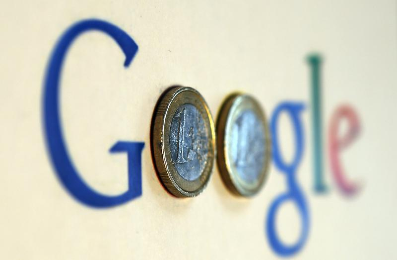 An illustration picture shows a Google logo with two one Euro coins