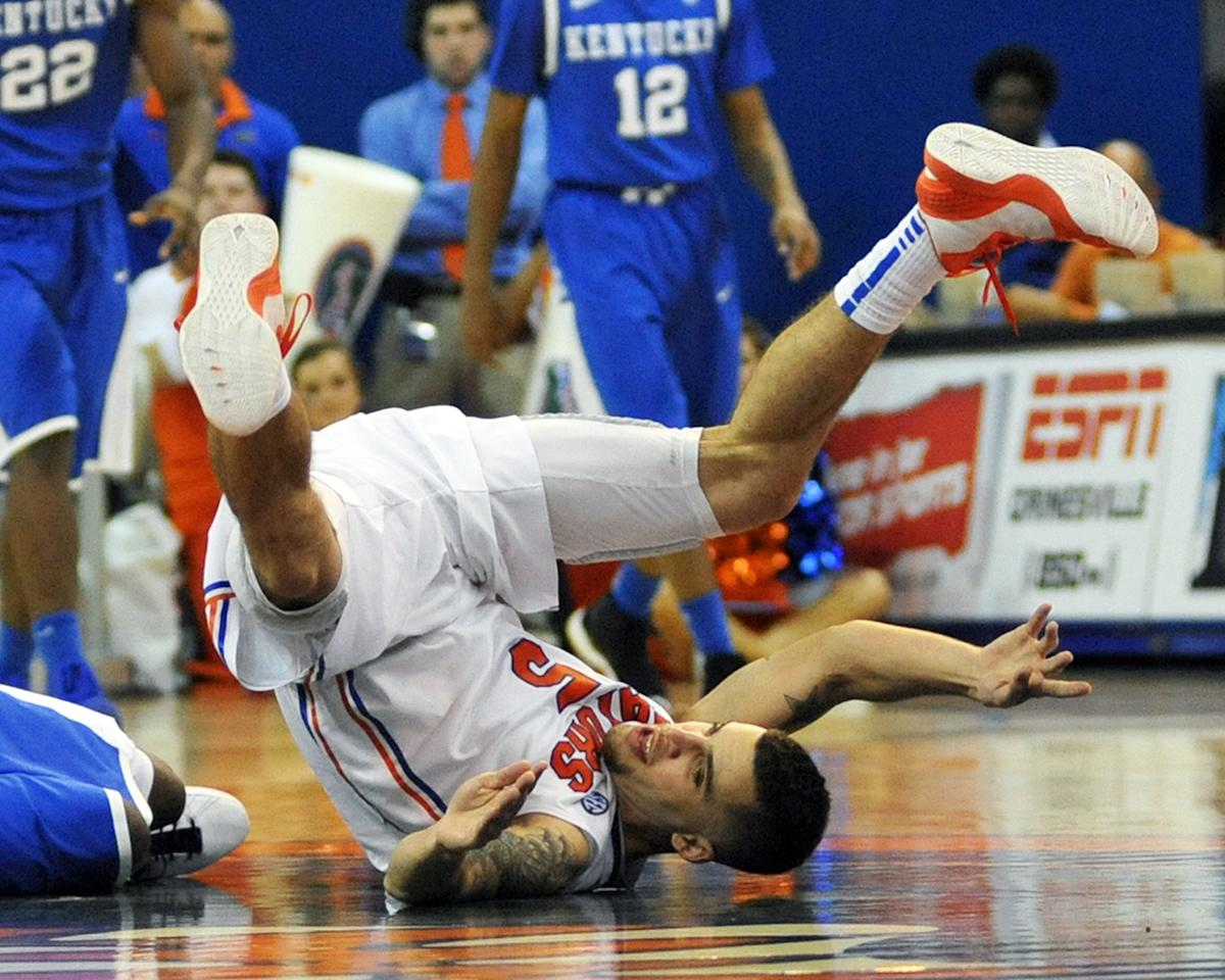 Guard Scottie Wilbekin #5 of the Florida Gators tumbles against the Kentucky Wildcats February 12, 2013 at Stephen C. O'Connell Center in Gainesville, Florida. The Gators won 69 - 52. (Photo by Al Messerschmidt/Getty Images)