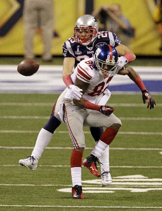 New England Patriots defensive back Sterling Moore (29) breaks up a pass to New York Giants wide receiver Mario Manningham (82) during the second half of the NFL Super Bowl XLVI football game, Sunday, Feb. 5, 2012, in Indianapolis. (AP Photo/Elise Amendola)