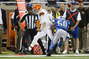 Johnny Manziel is forced out of bounds by Lions LB Travis Lewis. (AP)