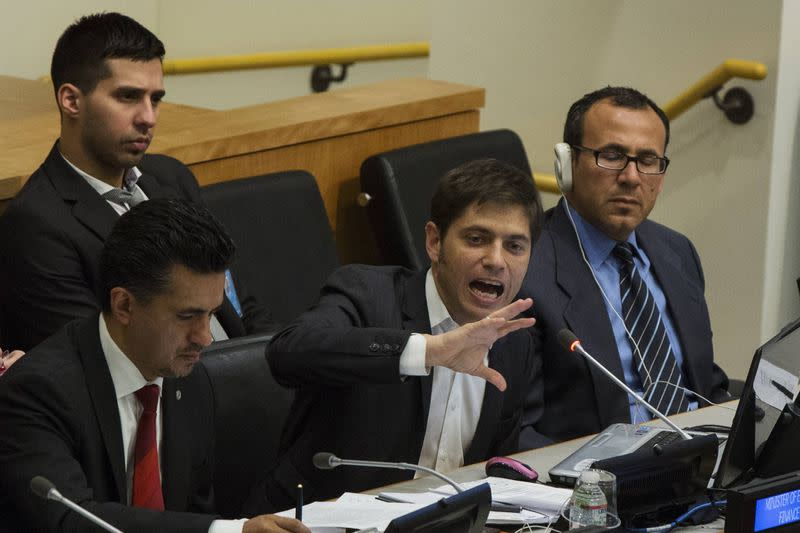 """Argentina's Economy Minister Axel Kicillof gives an address """"Sovereign Debt Restructuring: The Case of Argentina"""" next to Sacha Llorenti, Chairman of the Group of G77 at United Nations headquarters in New York"""
