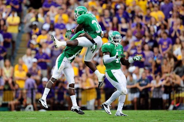 Zachary Orr #35 of the North Texas Mean Green celebrates a sack with teammates during a game against the LSU Tigers at Tiger Stadium on September 1, 2012 in Baton Rouge, Louisiana. LSU would win 41-14. (Photo by Stacy Revere/Getty Images)
