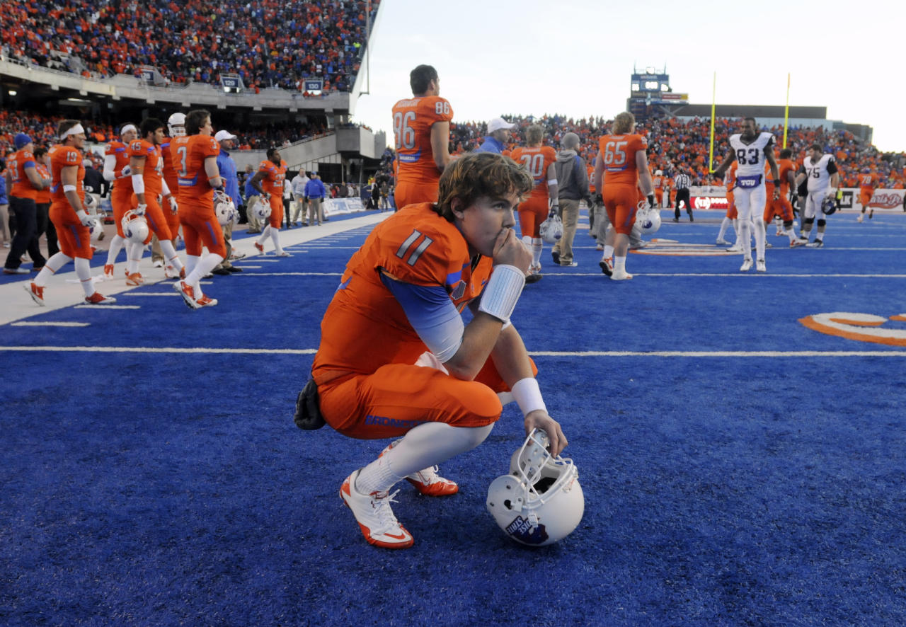 Boise State quarterback Kellen Moore reacts after losing to 36-35 to TCU in an NCAA college football game on Saturday, Nov. 12, 2011 in Boise, Idaho. (AP Photo/Idaho Press-Tribune, Charlie Litchfield) MANDATORY CREDIT