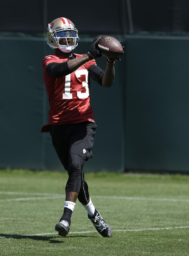 San Francisco 49ers wide receiver Stevie Johnson (13) catches a pass during NFL football mini-camp in Santa Clara, Calif., Tuesday, June 17, 2014